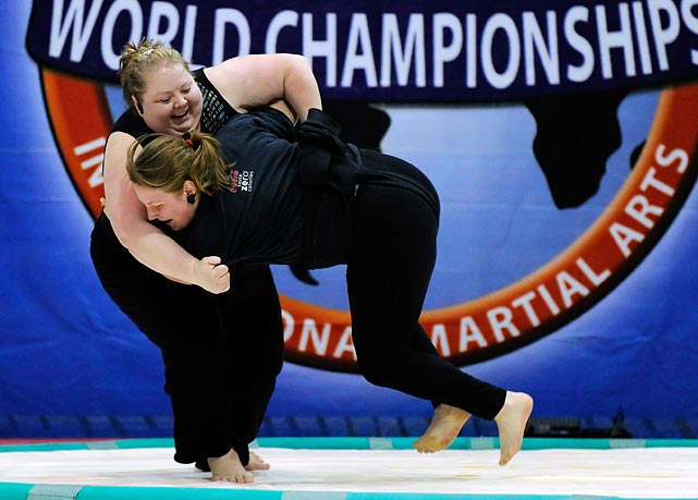 Taunia Arave (left) and Heather Colton battle during the U.S. National Sumo Championships.