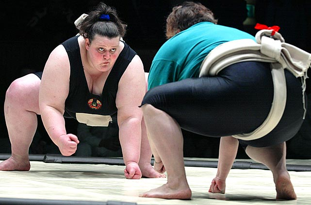 Veronica Kozlovskaya of Belarus stares down Maria Van Den Brink with the intensity of a tiger and the stance of a frog.