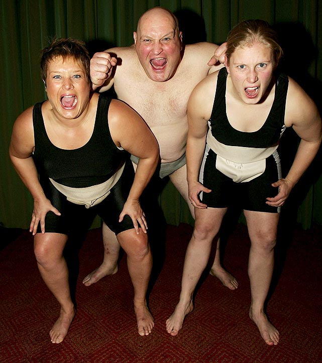 Adele Jones (left), Steve Pateman, president of the British Sumo Federation,  and Becky 'Pink' Williams channel their inner wrestler.