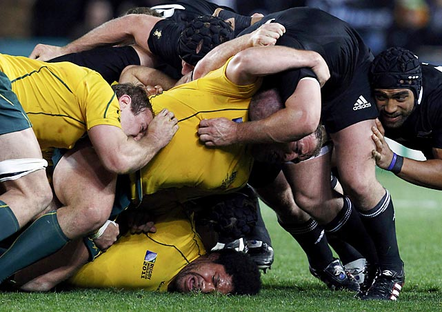The Australia Wallabies appear to be on the bottom half of the scrum during their Rugby World Cup match against the New Zealand All Blacks.