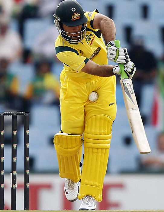 Australia's Ricky Ponting takes a ball low and inside.