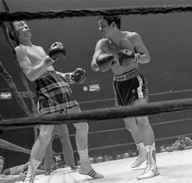 Duran was winning soundly en route to the lightweight championship, but the final blow of the bout was clearly low and left Scotland's Buchanan crumpled on the canvas. The referee basically ignored him and ruled it a knockout. It might not have been an unjust result, but the foul itself did cause some controversy.