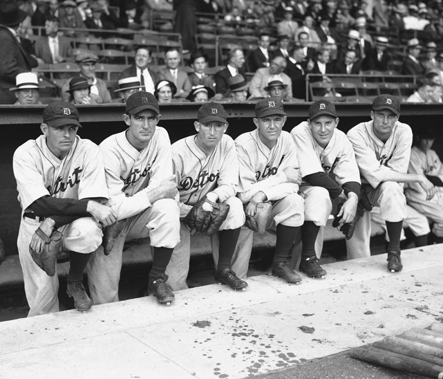 Tigers' pitchers Thomas Biridges, Eldon Auker, Victor Sorrell, Alvin Chowder, Carl Fischer and Luke Hamlin pose in the Tigers Stadium dugout for a 1934 photo. The Tigers' were AL Champions in 1934 and would win their first World Series the following year.