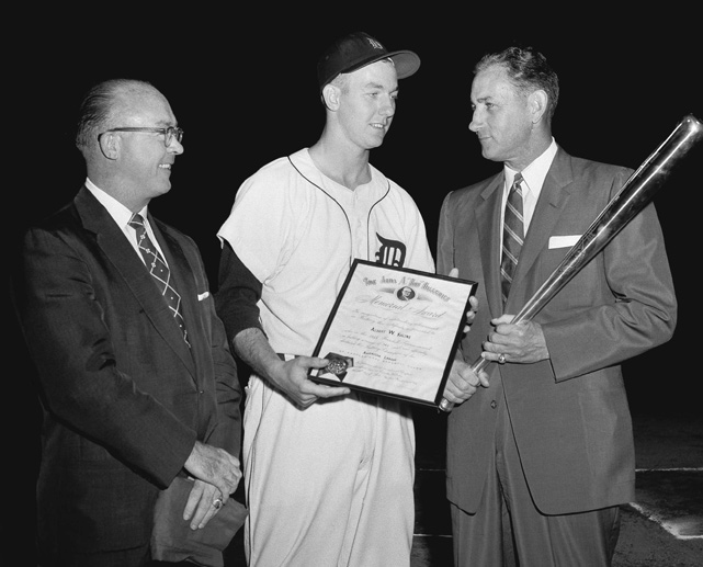 Tigers right fielder Al Kaline (center) is awarded the 1955 American League batting championship for his .340 avg. At 20 he was the youngest player ever to receive the award. Tigers vice president Charlie Gehringer, a former AL batting title holder, presented Kaline with the award.