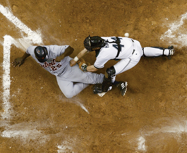 Dmitri Young slides in to score against Tampa. The Tigers lost an AL-record 119 games in 2003.