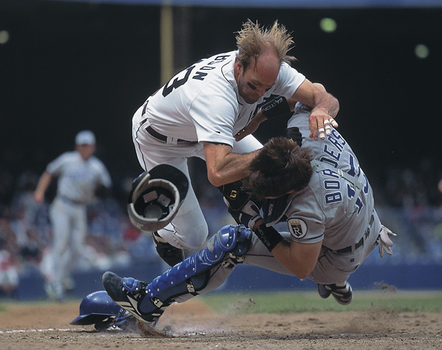 Gibson collides with Kansas City catcher Pat Borders to score a run during his final MLB season.