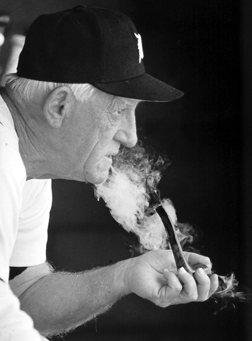 Anderson smokes his pipe in the dugout during a Grapefruit League game in Florida. He was the Tigers' manager from 1979 to 1995 and helped Detroit win the 1984 World Series. The Tigers retired Anderson's number 11 jersey. He was elected to the Baseball Hall of Fame in 2000.