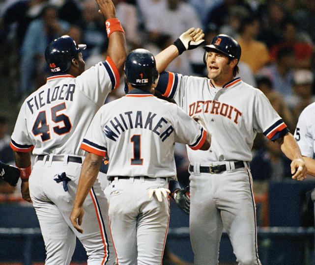 Kirk Gibson (right) high fives with Cecil Fielder after his first-inning grand slam on April 9, 1993. Gibson retired in 1995 and became a coach for the Tigers in 2003. He is currently the manager of the Arizona Diamondbacks.