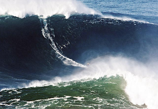 Garrett McNamara of Haleiwa, Hawaii, won the Biggest Wave surfed title, a 78-foot wall caught at Nazare, Portugal.