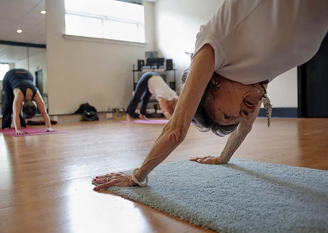 Yoga instructor Tao Porchon-Lynch, leading a class in Hartsdale, N.Y., was named the world's oldest yoga teacher at 93.