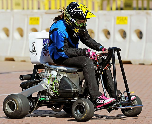 Canadian female action sports star Jolene Van Vugt makes a pass in Sydney on her way to setting a new land speed Guiness World Record for a motorized toilet. Van Vugt beat the existing record of 68 km/h by 7 km/h, after completing the stunt in both directions with an average of the two speeds taken to give her the new world record.