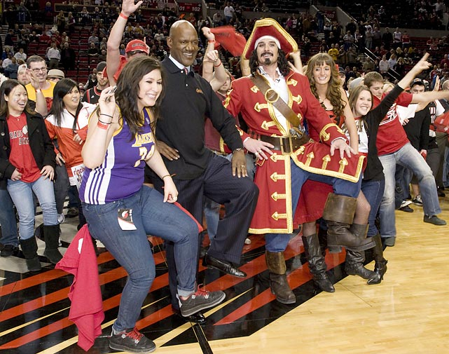 Portland Trail Blazers' legend Terry Porter (center) helps fans set the record for most people in the Captain Morgan pose at The Rose Quarter in Portland.