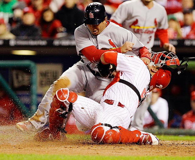 Jon Jay of the St. Louis Cardinals is tagged out Philadelphia's Carlos Ruiz. The Cardinals would come out on top 5-4 in Game 2 to even the divisional series.