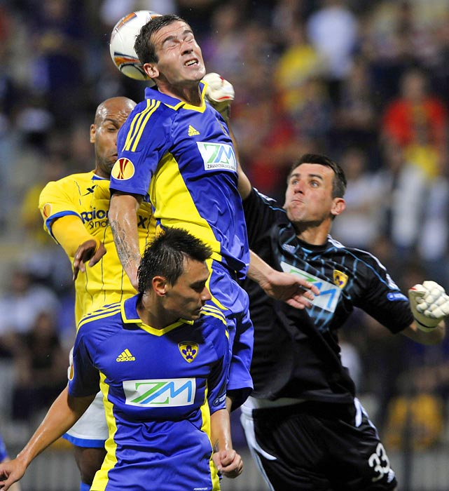 Maribor goalkeeper Jasmin Handanovic punches a ball out of danger during a Europa League match against Birmingham City.