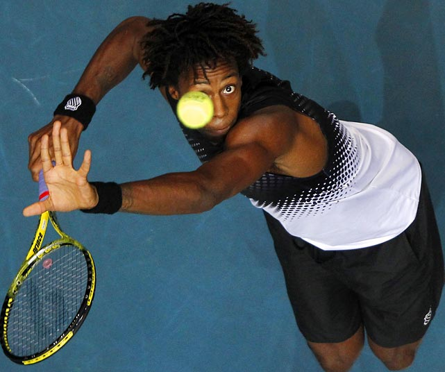 Gael Monfils serves to Donald Young during their semifinal match at the Thailand Open.