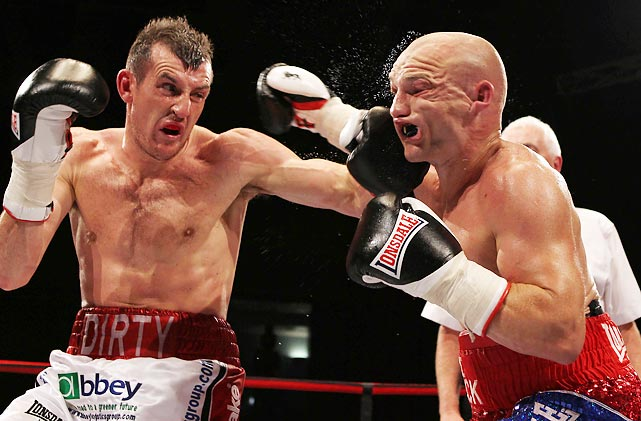Derry Matthews lands a left hook against Gavin Rees during the European Lightweight title fight in Wales that ended in a draw after Matthews sustained an injury on an incidental head butt.