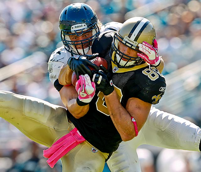 Saints tight end Jimmy Graham catches a pass while being defended by Jacksonville linebacker Paul Posluszny. The Jags didn't have any answers for Graham, who had 10 catches, 110 yards and a touchdown in New Orleans' 23-10 win.