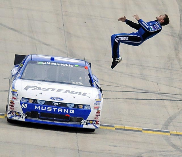 After winning at Dover, Carl Edwards does one of his signature back flips off of his racecar. Edwards is now fourth in the Sprint Cup points standings.