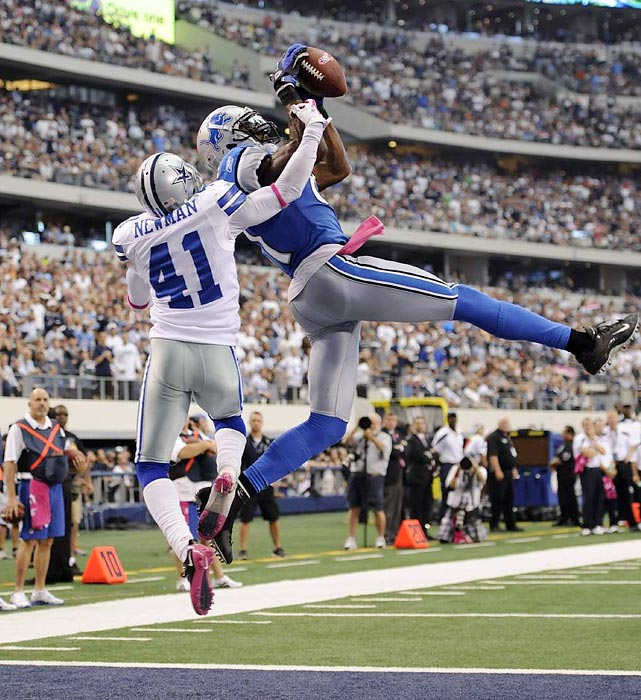 Calvin Johnson grabs one of his two touchdowns during the Lions' win over the Dallas Cowboys. Dallas blew a 24-point lead in its 34-30 loss.