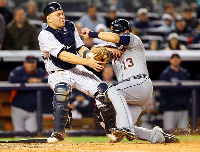 The Yankees' Russell Martin tags out fellow catcher Alex Avila during Game 1 of their ALDS matchup. The Tigers topped the Yanks 5-3.