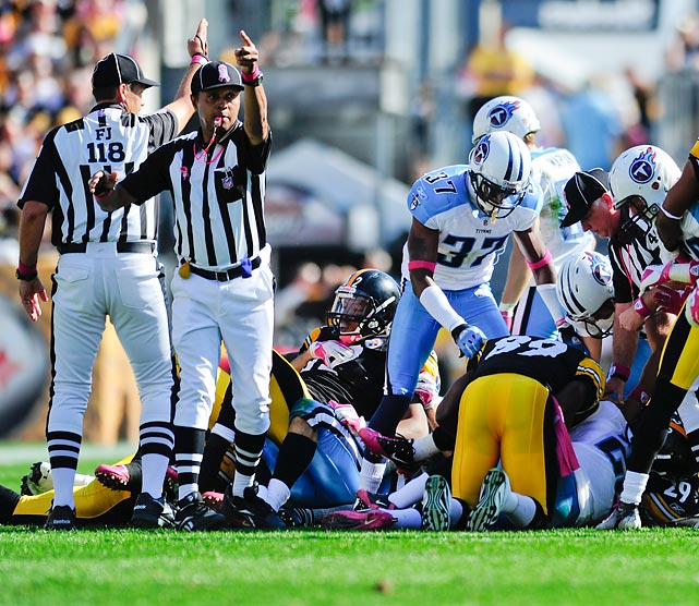 Officials signal that a fumble was recovered by Tennessee and Pittsburgh in their Week 5 matchup. The ball would eventually be given to the Titans, who would lose 38-17.
