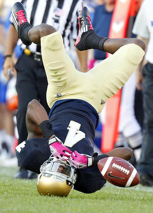 Cornerback Gary Gray leads with his helmet as he hits the turf attempting an interception against Air Force in Notre Dame's 59-33 victory.