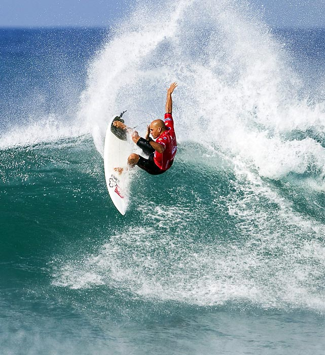 Reigning 10-time ASP World Champion surfer Kelly Slater of the United States catches a wave in a heat that would help him advance to round three during the Quiksilver Pro France in Hossegor.