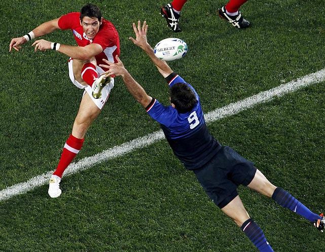 James Hook of Wales gets the ball past Dimitri Yachvili of France during the Rugby World Cup semifinals.
