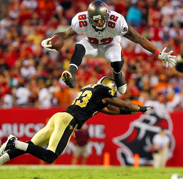 Tampa Bay tight end Kellen Winslow hurdles cornerback Jabari Greer during the Bucs 26-20 victory over New Orleans.