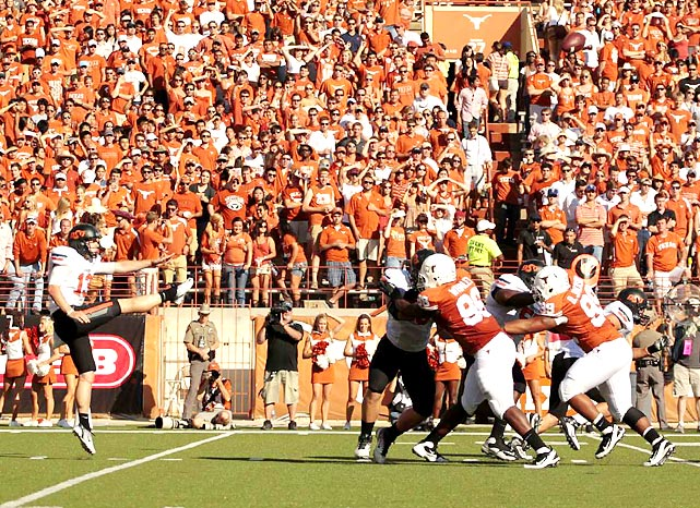 Oklahoma State punter Quinn Sharp kicks one of his six punts during the Cowboys' 38-26 victory at Royal-Texas Memorial Stadium in Austin.