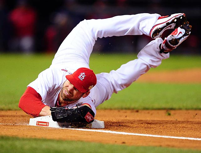 St. Louis pitcher Chris Carpenter makes a diving out at first base during the Cardinals' 3-2 victory in Game 1 of the World Series against the Texas Rangers.