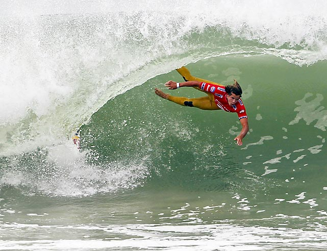Julian Wilson of Australia tries surfing without his board during the ASP Rip Curl Pro competition in Portugal.