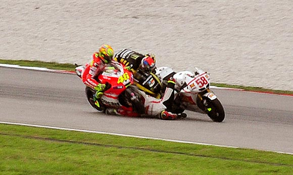 MotoGP riders Marco Simoncelli, Valentio Rossi and Colin Edwards collide during the Malaysian Grand Prix. Simoncelli died after the accident.