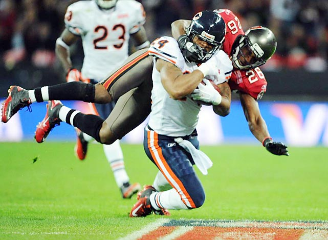 Chicago running back Marion Barber draws a facemask penalty during the Bears' 28-14 win over Tampa Bay at Wembley Stadium in London. Forte had 145 rushing yards and a touchdown .