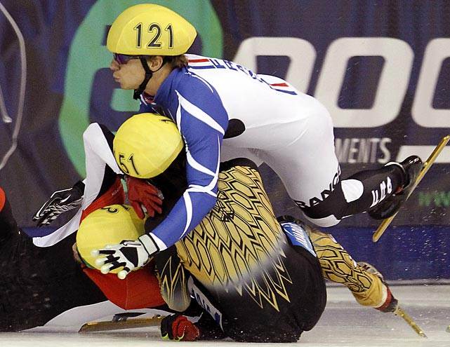 Francois Hamelin of Canada, Yuzo Takamido of Japan and Maxime Chataignier of France collide during the 1500 short-track semifinal at the ISU Korean Air World Cup.