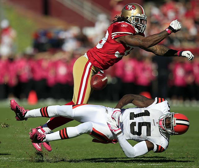 Cleveland receiver Greg Little can't come up with the catch after being drilled by 49ers safety Dashon Goldson. San Francisco's defense held the Browns to one touchdown points in the 20-10 win.