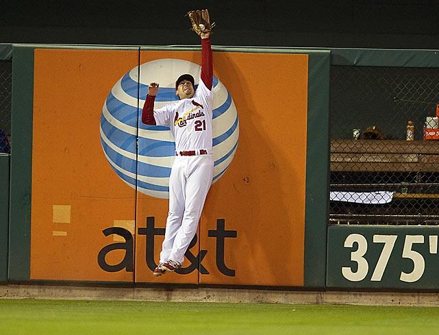 St. Louis left fielder Allen Craig steals a home run from Nelson Cruz during Game 7 of the World Series. The Cardinals won 6-2.