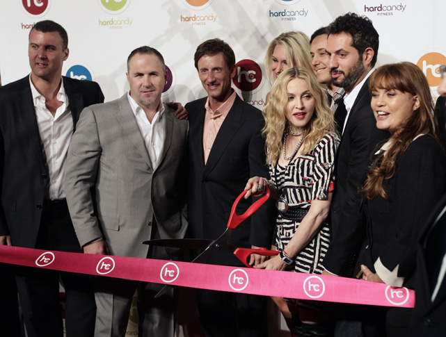 Madonna cuts the ribbon to officially open the Hard Candy Fitness gym in Mexico City.