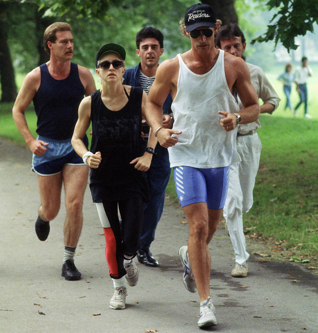 Madonna jogs in London's Green Park under the watchful eyes of her bodyguards in this 1997 photo.