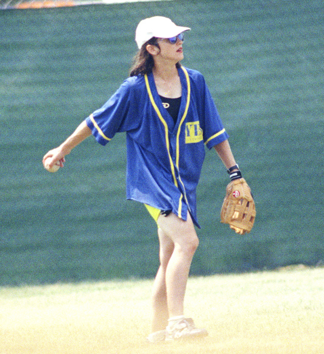 Before filming began, Madonna had to learn how to play baseball. In this photo, the singer works on her baseball skills during a summer in Chicago.