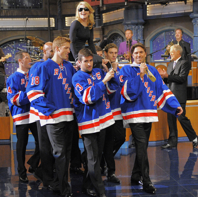 "Madonna enters a 2009 taping of  Late Show with David Letterman  while riding on the hockey sticks of the New York Rangers, who delivered the ""Top Ten List"" for the broadcast."