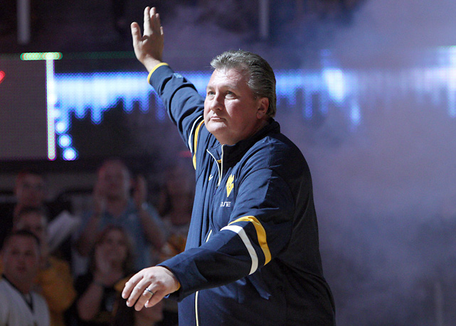 West Virginia coach Bob Huggins greets the crowd during NCAA college basketball Mountaineer Madness at WVU Coliseum.