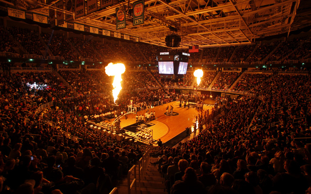 Pyrotechnics illuminate the Breslin Center as Michigan State players are introduced before the annual Midnight Madness scrimmage.