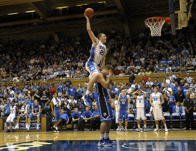 "Duke's Miles Plumlee pushes off his younger brother Marshall during a dunk contest at the ""Countdown to Craziness"" preseason NCAA college basketball event in Durham."