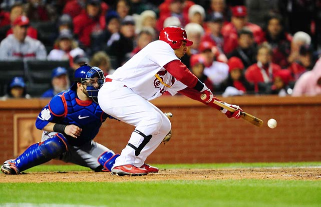 Cardinals' centerfielder Jon Jay lays down a sacrifice bunt in the fifth inning.