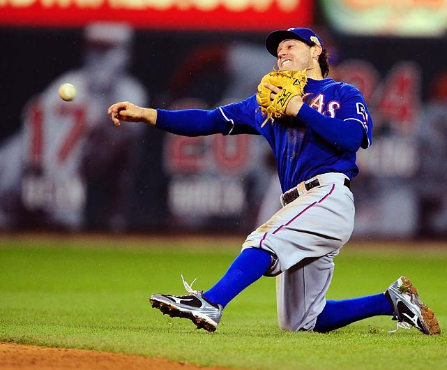 Ian Kinsler throws to first base. the Texas second baseman helped turn two double plays in Game 1.