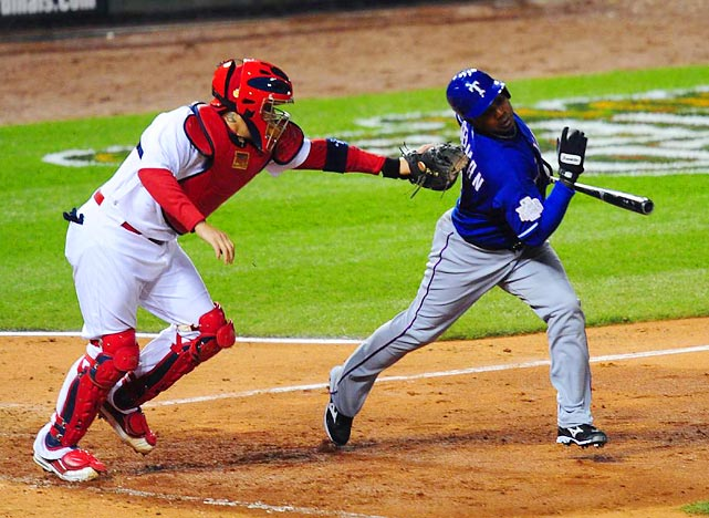 Yadier Molina tags out pinch hitter Esteban German after he struck out in the seventh inning.
