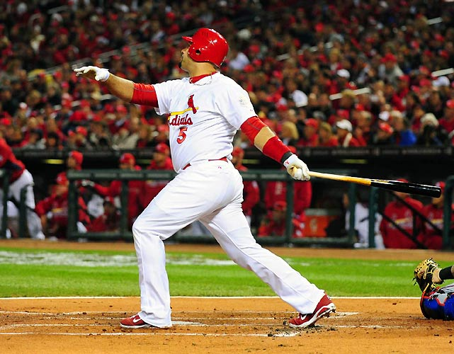 Albert Pujols holds his follow through after flying out during Game 2 of the World Series.