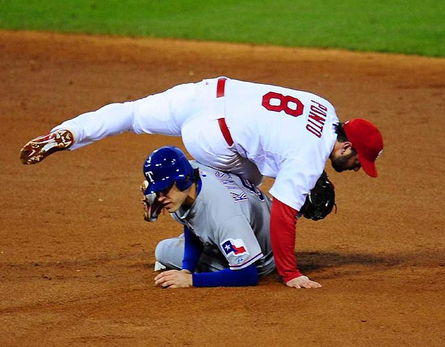 Cardinals second baseman Nick Punto and Rangers second baseman Ian Kinsler collide after St. Louis turned a double play in the fourth inning.
