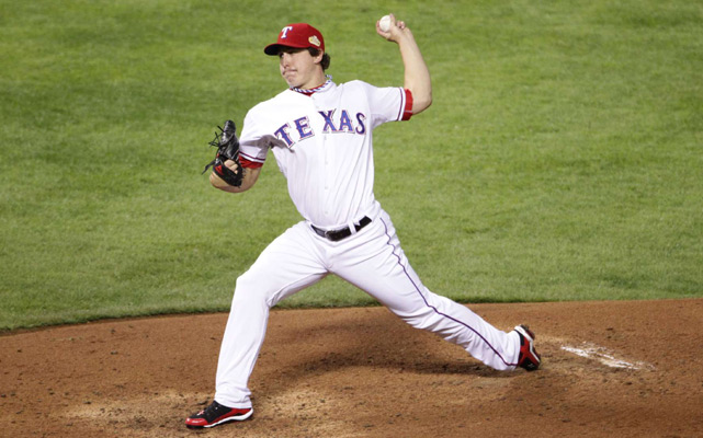 Rangers starting pitcher Derek Holland held the Cardinals to just two hits and two walks before leaving with one out in the ninth inning.